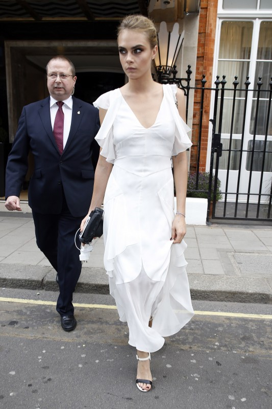 Cara Delevingne in a white Chanel Dress for Sister Poppy's Wedding