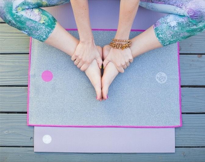 Girl sitting on yoga mat