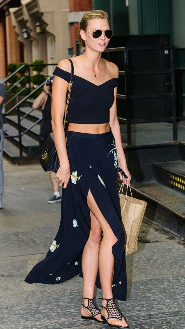 Karlie Kloss visits Taylor Swift in a crop top and floral skirt