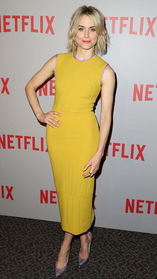 Taylor Schilling attends a screening in a mustard yellow Roksanda dress