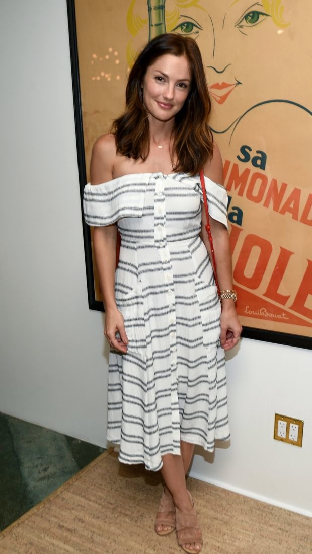 Minka Kelly wears a striped off-the-shoulder dress for The French Beauty Solution