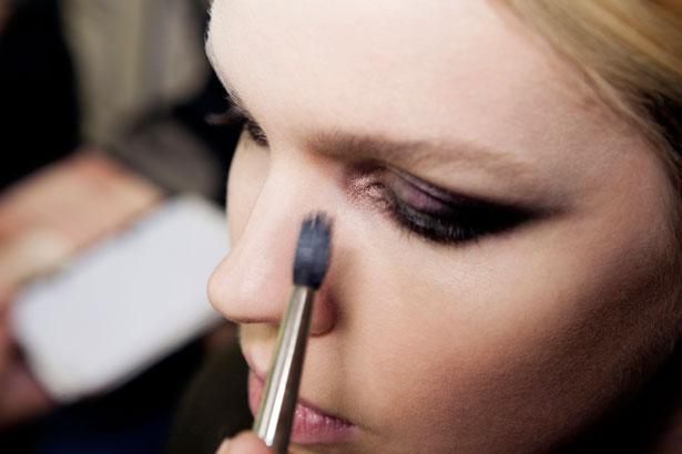 model getting eyeshadow applied with antibacterial makeup brush