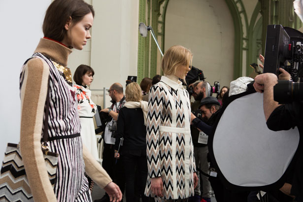 models backstage at a fashion show