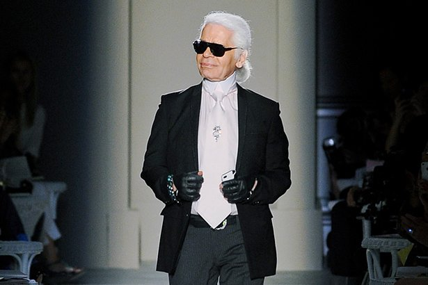 Karl Lagerfeld closes a Chanel runway show.