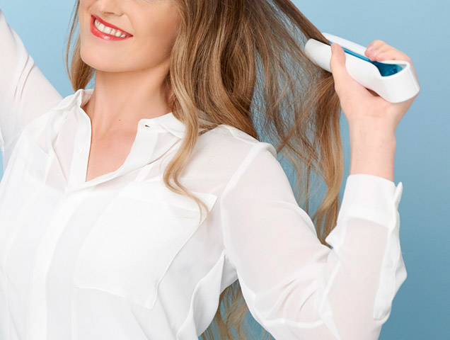 Woman using Inverse hair care system