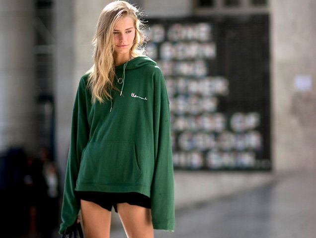 woman wearing sweatshirt and shorts