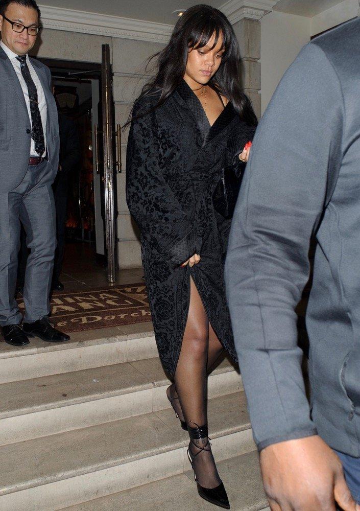 Rihanna wearing an Alexander McQueen robe coat to dinner.