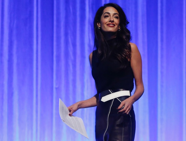 Amal Clooney in a Givenchy leather skirt.