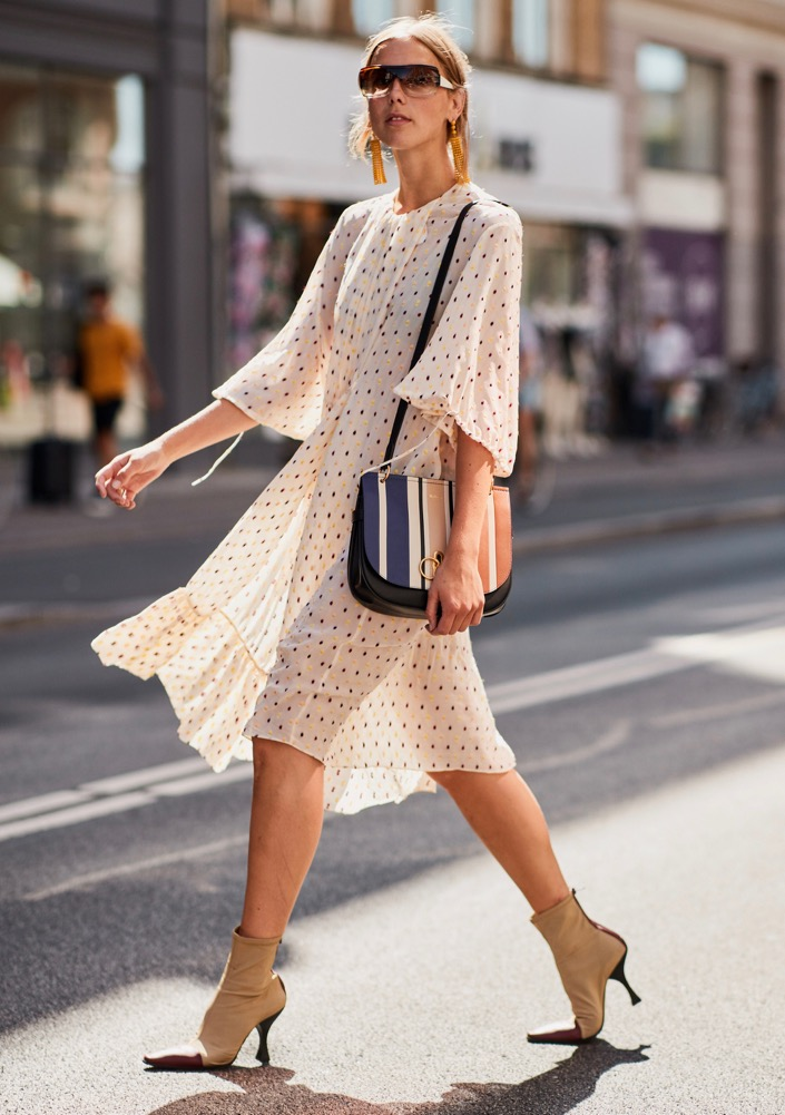 Boots teamed with a summery dress.