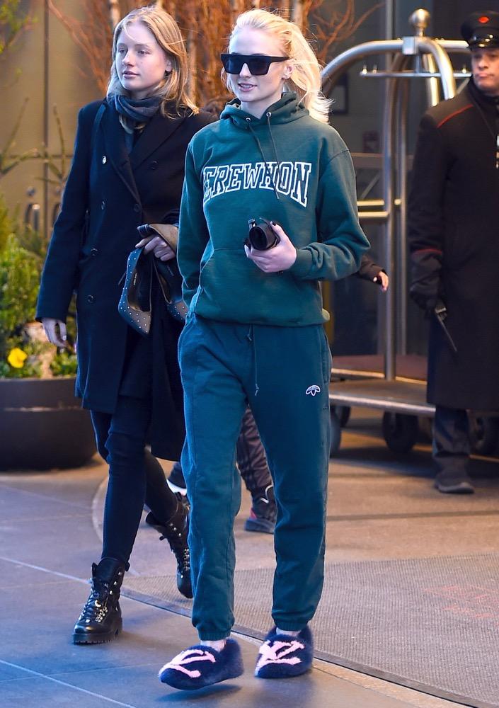 Sophie Turner sporting slippers outside.