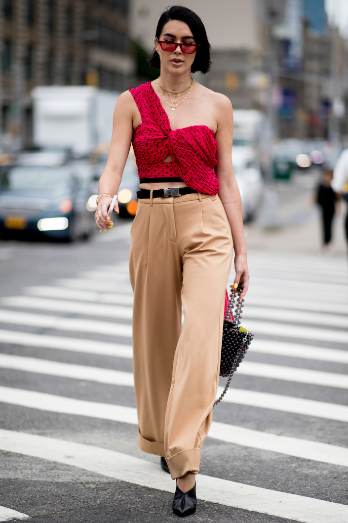 A one-shoulder top via street style.